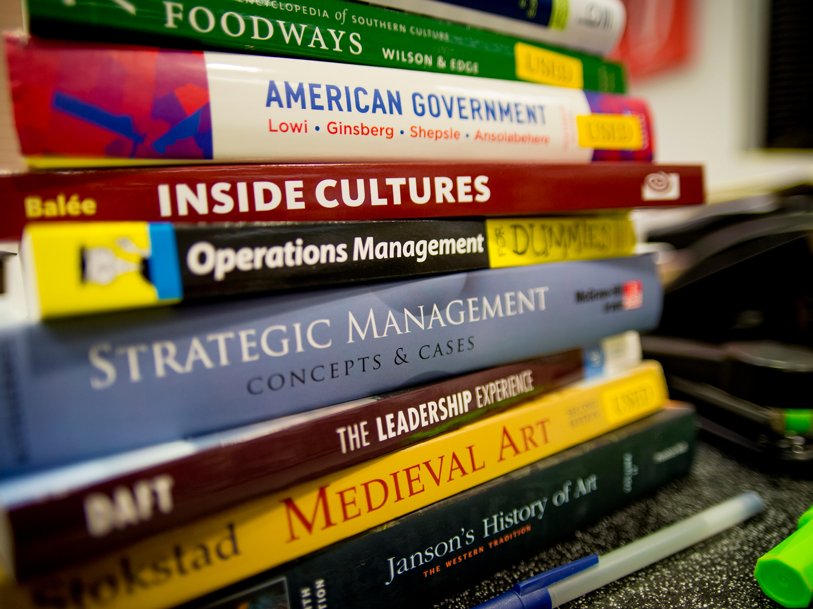 Stack of School of Liberal Arts textbooks.